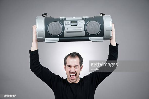 man lifts a huge ghettoblaster and shouts