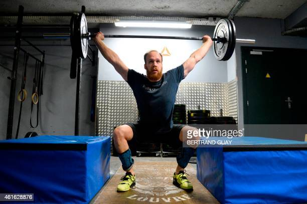 A man lifts weight during a crossfit training in a gym in Paris on January 16 2015 AFP PHOTO / BERTRAND GUAY
