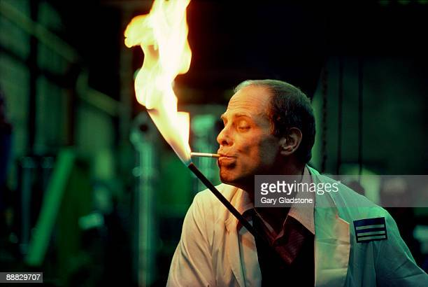 Man lighting cigarette with torch