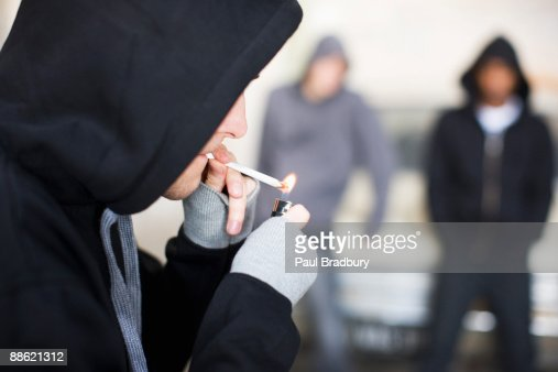 Man lighting marijuana cigarette