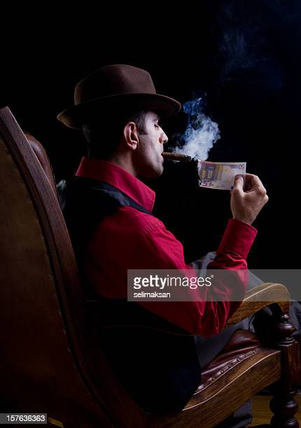 Man lighting up a cigar with Euro