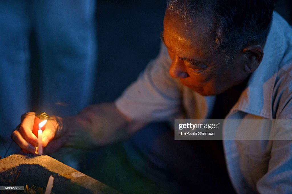A man lights a candle at a monument to commemorate the victims of the atmic bomb at the Hiroshima Memorial Park on August 6, 2012 in Hiroshima, Japan. Hiroshima marks the 67th anniversary of its atomic bombing under the shadow of the Fukushima nuclear disaster and by issuing a plea for complete nuclear disarmament.