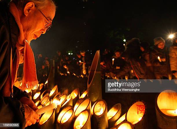 A man lights a candle for victims of the 1995 'Great Hanshin earthquake' during a memorial ceremony on January 17 2013 in Kobe Japan Memorial...