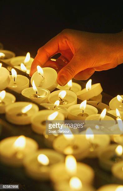 A man lights a candle in the memory of the late Pope John Paul II in Westminister Cathedral on April 3 2005 in London England The 84yearold Pontif...