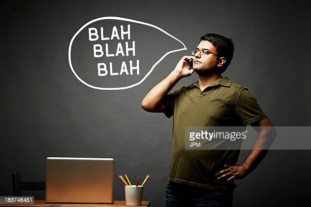 Man listening intently on mobile phone