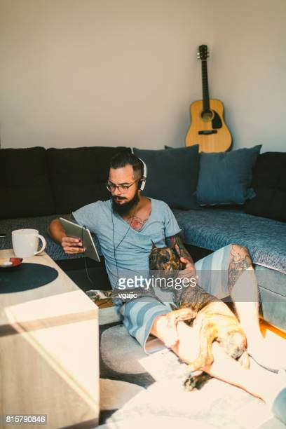 Man listening music at home