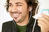 Man listening on earphones