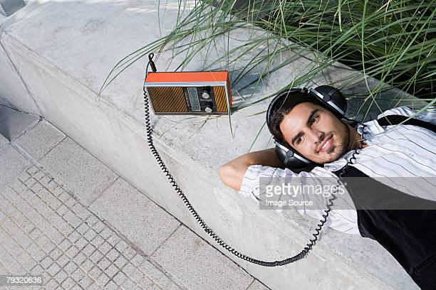 Man listening to a retro radio