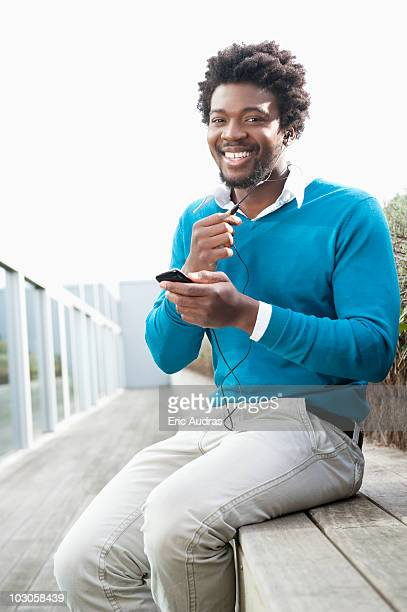 Man listening to an MP3 player