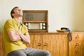 Man listening to antique radio