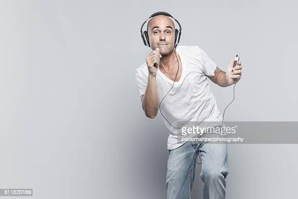Man listening to headphones and dancing