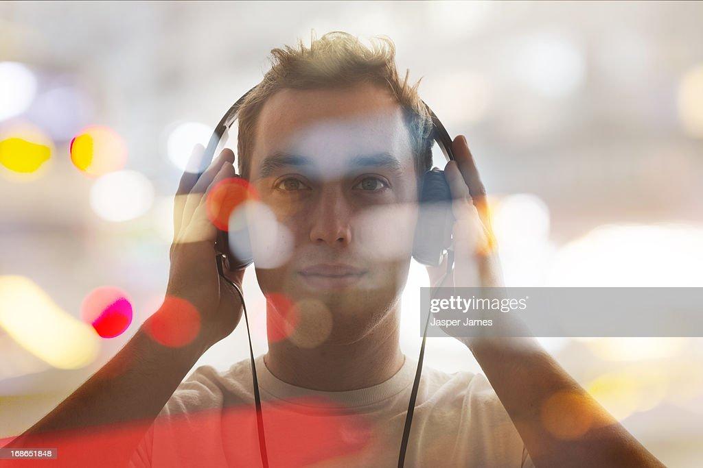 man listening to headphones : Stock Photo