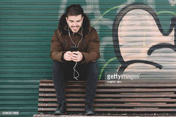 Man listening to music and surfing the net