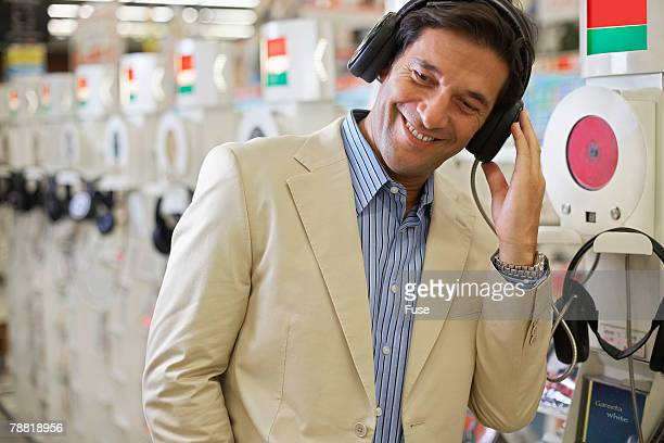 Man Listening to Music in Record Store