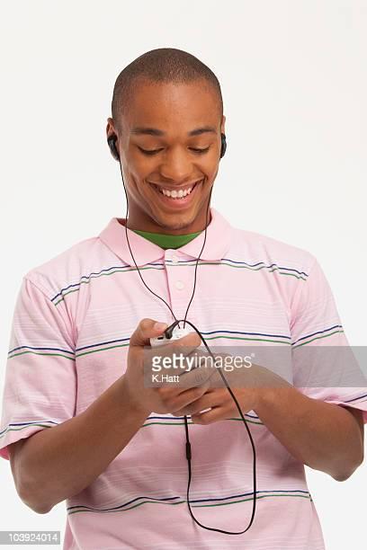 Man listening to music on earphones