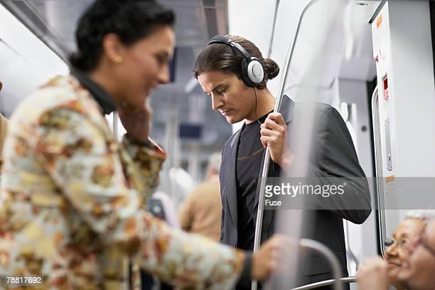 Man Listening to Music on Subway