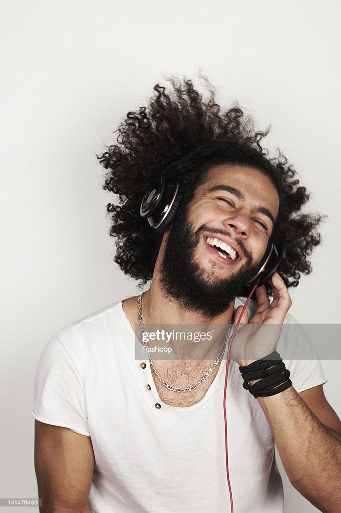 Man listening to music with headphones : Stock Photo