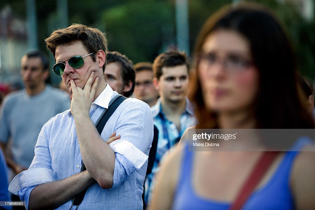 A man listens to a speech during the protest against the caretaker government of Czech Prime Minister Jiri Rusnok on August 6, 2013 in Prague, Czech Republic. Rusnok's caretaker cabinet, which Czech President Milos Zeman appointed July 10 despite protests from most political parties in the Czech Chamber of Deputies, will go through a vote of confidence in parliament tomorrow, August 7. Leaders of the former center-right coalition parties said they will not support Rusnok's government in tomorrow's vote.