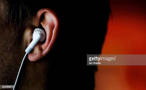 A man listens to an iPod MP3 player through earphones August 17 2005 in Sydney Australia Research conducted by the National Acoustic Laboratories to...