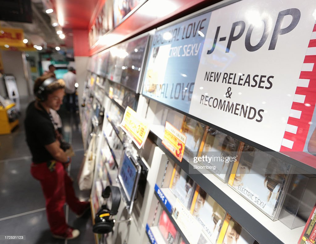 A man listens to Japanese pop music (J-Pop) at a Tower Records Japan Inc. store in Tokyo, Japan, on Monday, July 1, 2013. Music sales in the country rose for the first time in five years, led by tunes delivered on CDs and other physical media, bucking the trend in developed markets as cheaper downloads gain ground. Physical media made up 82 percent of Japanese music sales last year, versus 37 percent in the U.S., said the Recording Industry Association of Japan. Photographer: Yuriko Nakao/Bloomberg via Getty Images