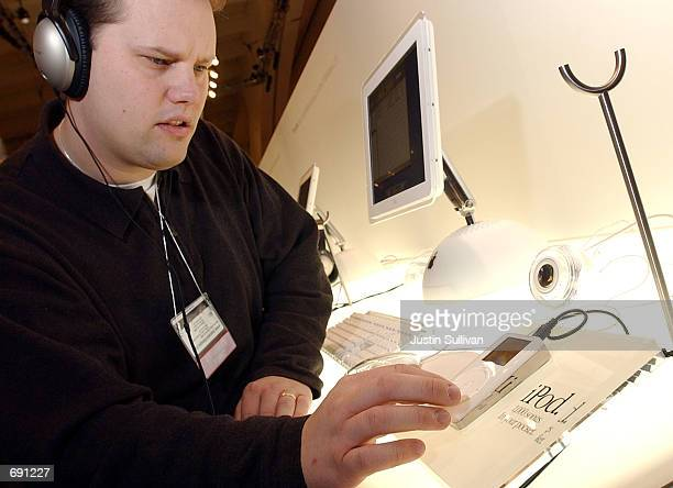 A man listens to MP3 music on a Apple iPod on display during the Macworld Conference and Convention January 8 2002 at the Moscone Center in San...