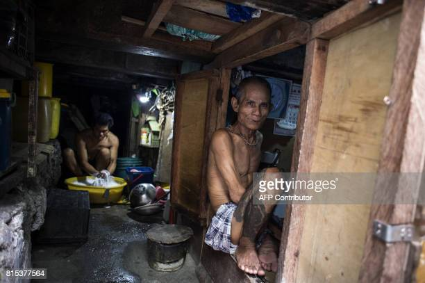 A man living under the Estero de Vitas bridge washes clothes at his home in Tondo in Manila on July 16 2017 The Philippine economy has sustained one...