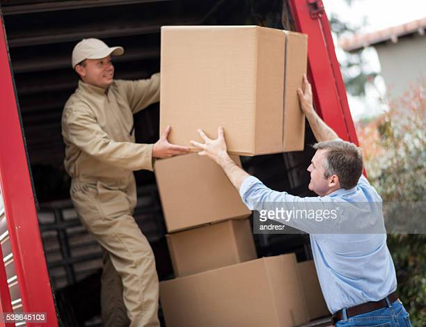 Man loading a moving truck with movers