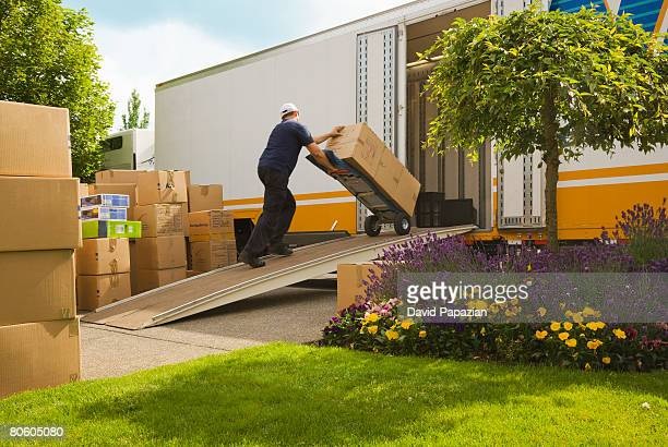Man loading boxes into truck