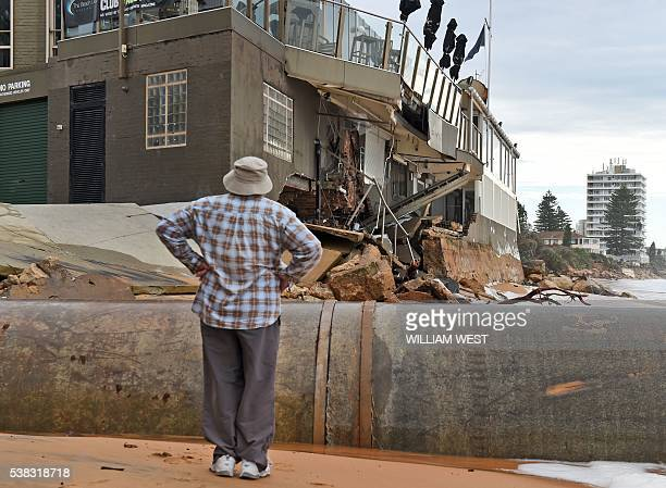 A man locals at the damage caused by a severe storm at Collaroy on Sydney's northern beaches on June 6 2016 Wild weather which has smashed into...