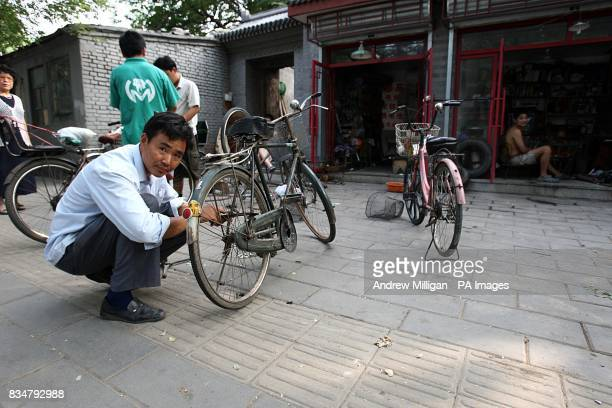 A man locks up his bicycle in Old Beijing China