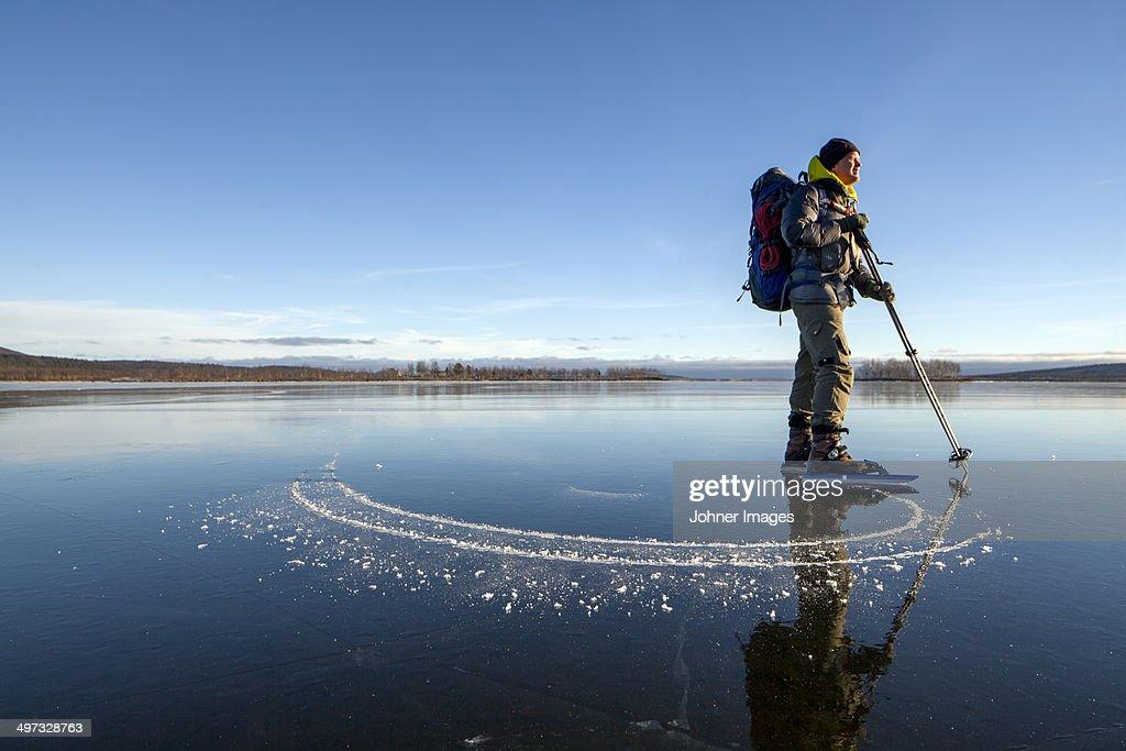 Man long-distance skating, Kiruna, Lapland, Sweden