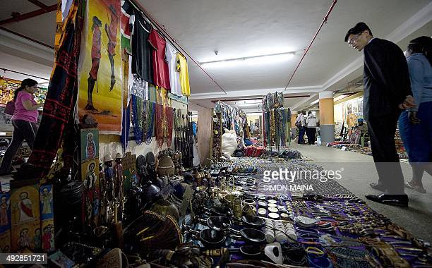 A man look at wares on May 22 2014 at the Maasai market in Nairobi a few days after hundreds of British tourists have been evacuated from beach...