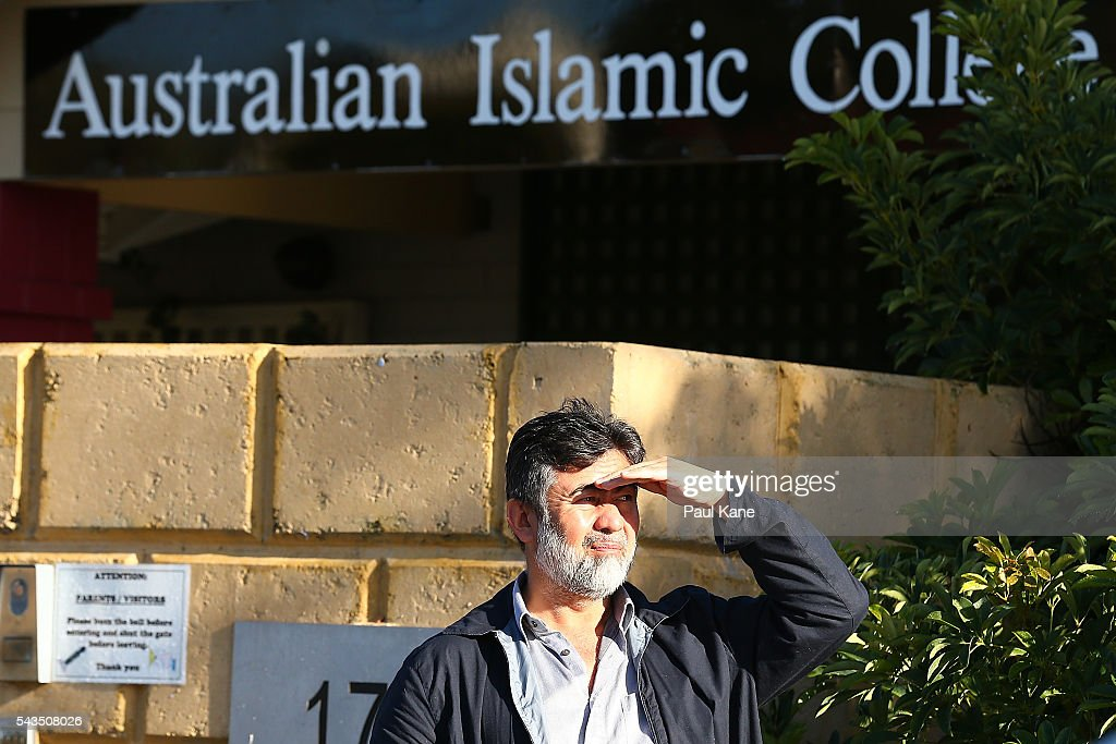 A man look on from outside the Thornlie Australian Islamic College and Mosque on June 29, 2016 in Perth, Australia. Police are investigating a firebomb attack which occurred last night at the Thornlie Mosque. No one was injured in the attack which took place during evening prayers.