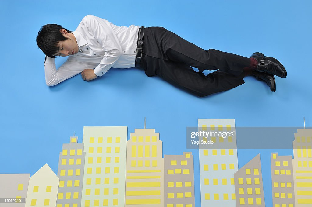 Man looking at a building : Stock Photo