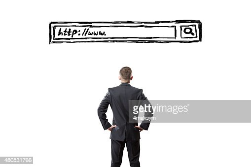Man looking at a search bar on a virtual screen : Stock Photo