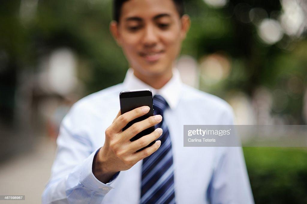 Man looking at a smart phone : Stock Photo