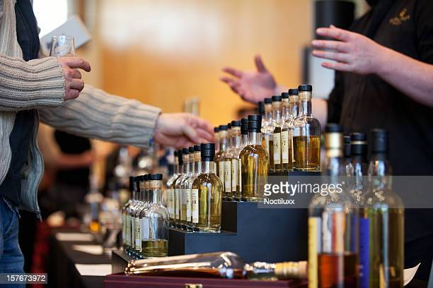 Man looking at a whiskey bottle display