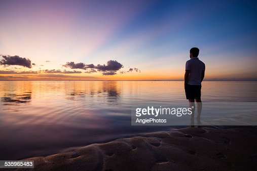 Man looking at beautiful sunset sky : Stock Photo