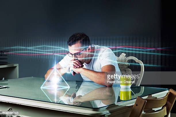 Man looking at business graph through projector