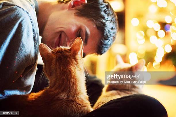 Man looking at cat
