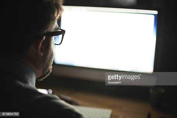Man looking at computer monitor
