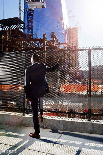 Man looking at construction site