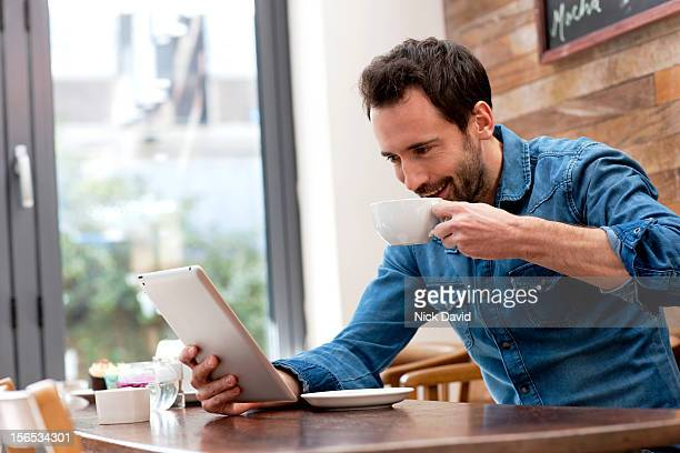 man looking at digital tablet