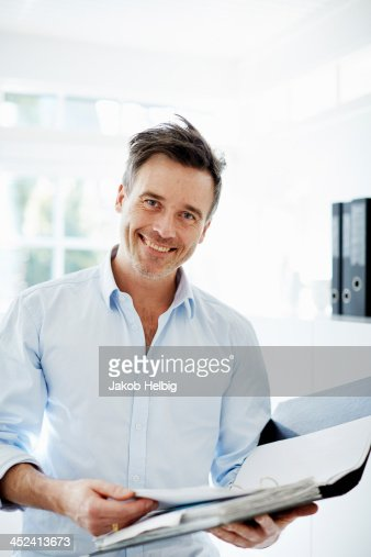 Man looking at folder of paperwork