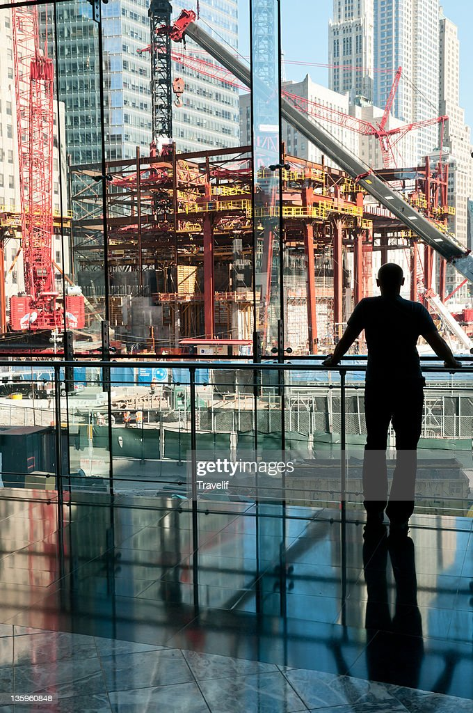 Man looking at Freedom Tower construction site : Stock Photo