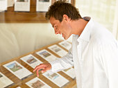 Man looking at homes for sale