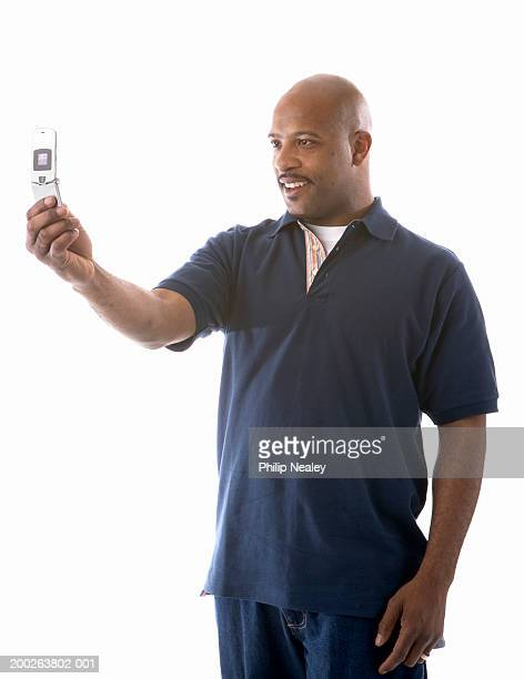 Man looking at image on mobile phone