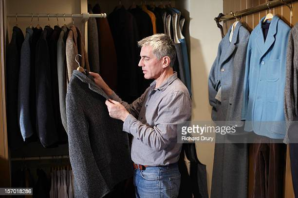 Man looking at jacket in clothes shop
