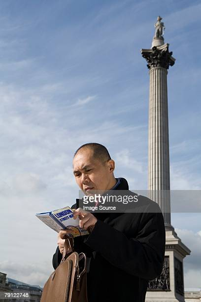 Man looking at map in London