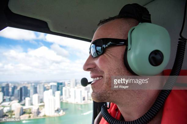 Man Looking At Miami Skyline During Helicopter Flight